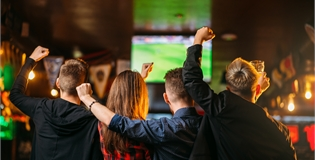 image of people watching a football match